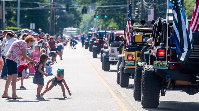 This file photo shows a crowded downtown Prattville during an Independence Parade in 2019. A new trolley service will help alleviate parking concerns in the area.