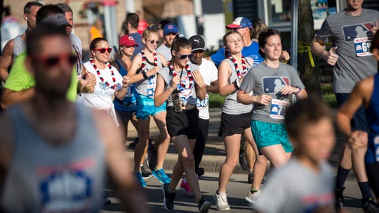 Runners take to the streets on July 4 during the annual Four for the Fourth race in downtown Yorktown. The annual race helps raise money for trails in Yorktown.