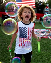 Eli McCoy chases bubbles at Lee Victory Recreation Park during Smyrna's 2019 Independence Day celebration. The town has canceled this year's event.