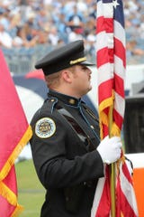 Nashville Police Officer John Anderson at Nissan Stadium. Metro police say Anderson died in a crash involving a 17-year-old driver in downtown Nashville on Thursday, July 4, 2019
