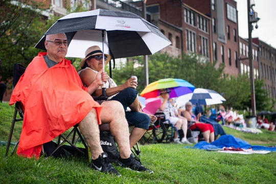 Winslow and Sheila De La Mora, of Franklin, Tenn., keep dry under umbrellas as rain falls on Riverfront Park during the Let Freedom Sing! Music City July 4th event in Nashville, Tenn., Thursday, July 4, 2019.