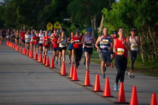 Runners begin their their final lap in the Moe's Firecracker 5k race on Thursday in Naples.