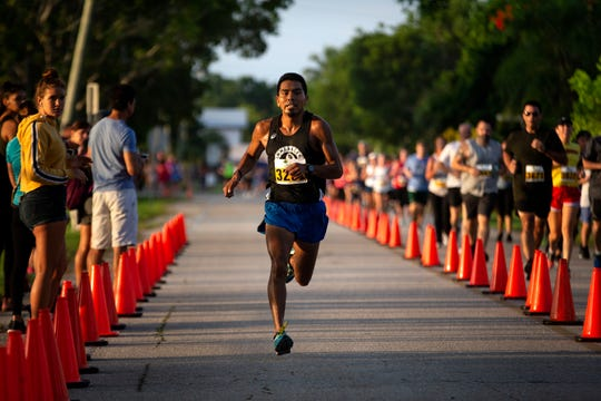 Argeo Cruz finishes first in the Moe's Firecracker 5k race, Thursday, July 4, 2019 in Naples.