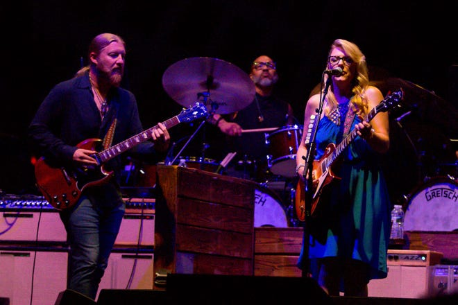 Derek Trucks, left, and wife Susan Tedeschi perform with their band July 3, 2019, at the Wharf Amphitheater in Orange Beach, Alabama.