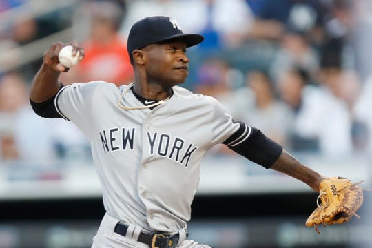 New York Yankees starting pitcher Domingo German winds up during the first inning of the team's game against the New York Mets, Wednesday, July 3, 2019, in New York.