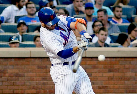 Jul 3, 2019; New York City, NY, USA; New York Mets first baseman Pete Alonso (20) doubles against the New York Yankees during the third inning at Citi Field.