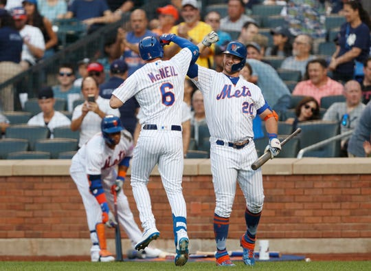 New York Mets' Jeff McNeil (6) celebrates with on-deck batter Pete Alonso (20) after hitting a solo home run during the first inning of the team's game against the New York Yankees, Wednesday, July 3, 2019, in New York.