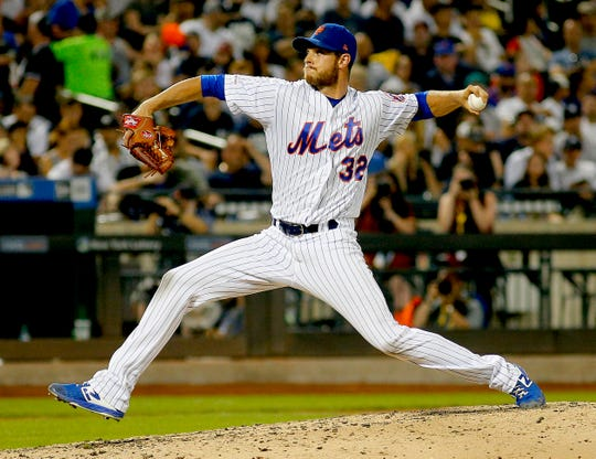 Jul 3, 2019; New York City, NY, USA; New York Mets pitcher Steven Matz (32) pitches in relief against the New York Yankees during the seventh inning at Citi Field.