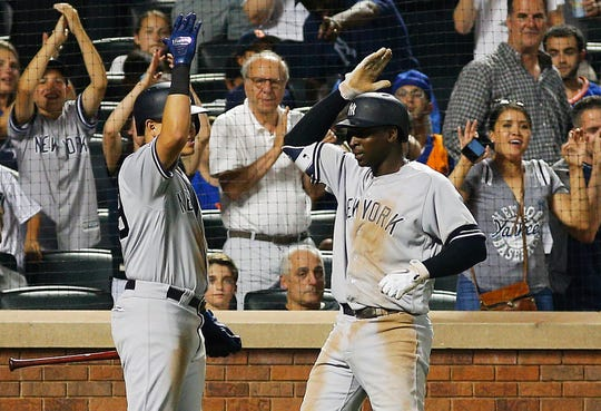 Jul 3, 2019; New York City, NY, USA; New York Yankees shortstop Didi Gregorius (right) is congratulated by third baseman Gio Urshela (29) after hitting a solo home run against the New York Mets during the sixth inning at Citi Field.