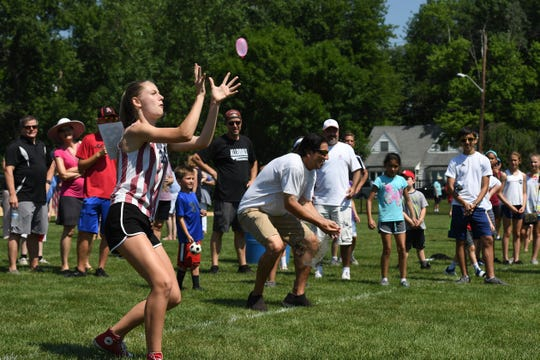 The Holiday Observers' July Fourth celebration at Grandstand Field in Allendale on Thursday, July 4, 2019. Sophia Chieffi on her way to making a catch and winning the water balloon toss.