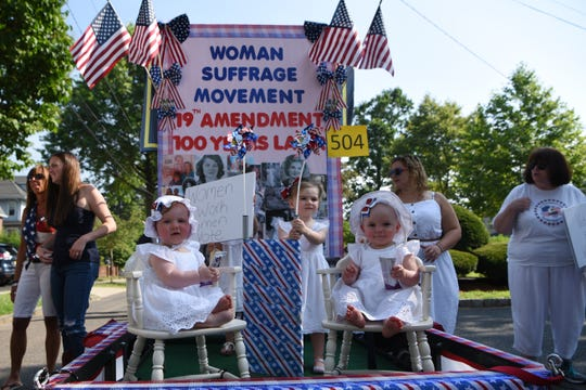 A woman suffrage movement themed float in the Baby and Youth parade in Ridgefield Park on Thursday July 4, 2019. 