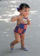 One-year-old Mia Ballinas made a fashion statement with her patriotic swimsuit at Luna County Courthouse Park.