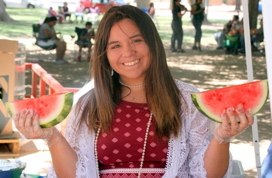 Tatum O'Toole served up refreshing watermelon slices to support Luna County 4-H during the Fourth of July celebration at Luna County Courthouse Park in Deming, NM.