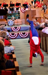 "Takoda Winer performs an acrobatic dance during the July 4 ""Musical Tribute to America"" at the First Presbyterian Church in Farmington."