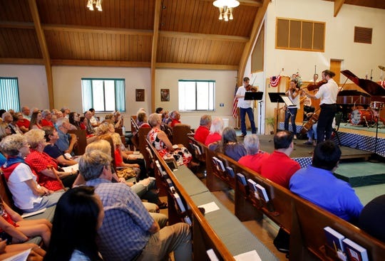 "The Classical String Quartet performs during the July 4 ""Musical Tribute to America"" at the First Presbyterian Church in Farmington."