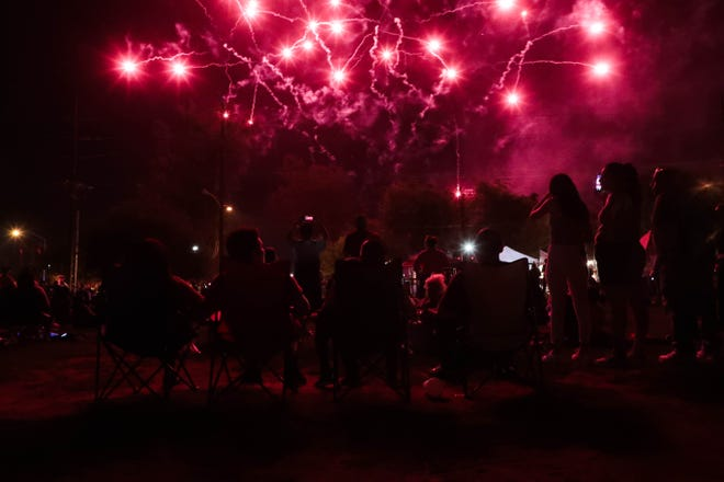 People watch a fireworks display at an early Independence Day celebration at Bagdouma Park in Coachella, Calif. on Wednesday, July 3, 2019.