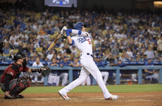 Dodgers first baseman Cody Bellinger hits a walk-off solo home run in the tenth inning against the Diamondbacks on July 3 at Dodger Stadium.
