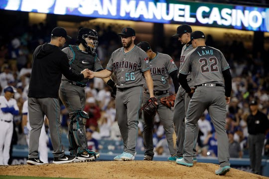Diamondbacks manager Torey Lovullo pulls Diamondbacks closer Greg Holland during the ninth inning of a game against the Dodgers.
