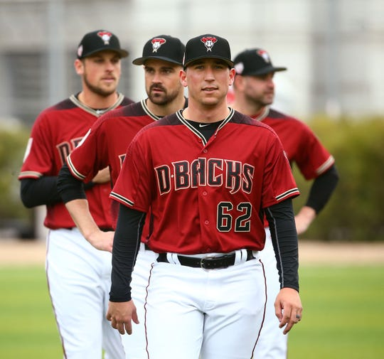 Diamondbacks pitcher Taylor Widener (62) looks on during the first day of spring training workouts at Salt River Fields.