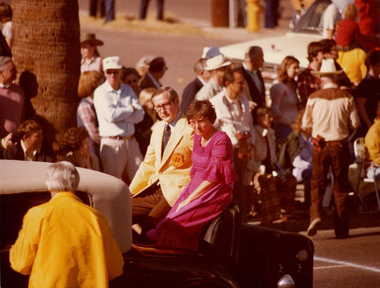 Donald Dupont, one of the founders of the Fiesta Bowl, rides in a car in the Fiesta Bowl Parade in 1979, when he was Fiesta Bowl president.