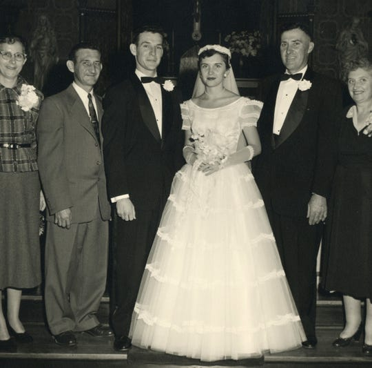 Donald Dupont and his wife, Janet, got married in October 1954. Their parents stand on either side of them for this wedding photo.