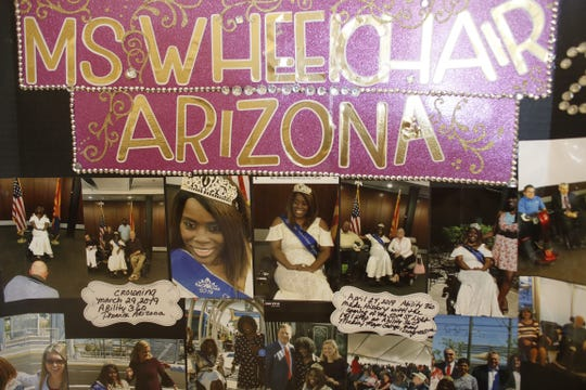 A board showing off Shawnique Cotton's role in her community in her home in Mesa, Ariz. on June 30, 2019.