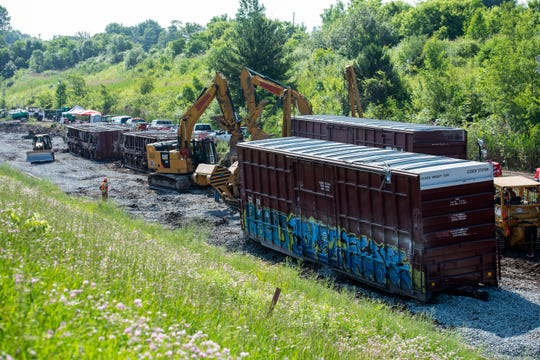 Crews work to remove damaged train cars Thursday, July 4, 2019, at the site of last Friday's derailment in the international tunnel to Sarnia. CN Rail hopes to have the tracks open sometime next week.