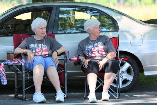 Diane Miller (left) and Lorna Davis enjoy the Town of Hyde Parks' independence Parade on Thursday, July 4, 2019. The two said they have been attending the parade since they were teenagers.