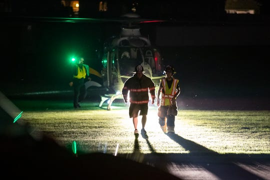 First responders return to their vehicles after transporting Tommy Brady to a medical helicopter after a firework blew up in his face, Wednesday, July 3, 2019, in McSherrystown.