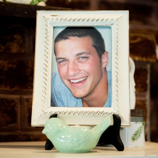 Nine years ago, Patrick Dolan was stabbed and eventually died of his injuries in Baltimore. He was 19. His parents keep a framed picture of him on the mantel of their fireplace, July 2, 2019.