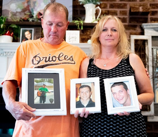 Bill and Dee Dolan, of Dover, lost their sons (left to right) Bill, Joseph and Patrick. Bill overdosed after being released from prison, but they don't know from what drug(s). Joseph also overdosed but on carfentanil, a synthetic opiate typically used to sedate large animals. And Patrick was stabbed in Baltimore after someone tried to steal his wallet. Now, the parents who lost so much try to help others struggling with addiction and those who have lost loved ones. They are pictured  in their home holding photos of their sons who died. Read the full story here: bit.ly/2YcC8Lx