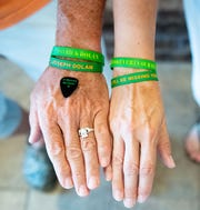 Bill and Dee Dolan have wristbands and a guitar pick to remember to their children, July 2, 2019.