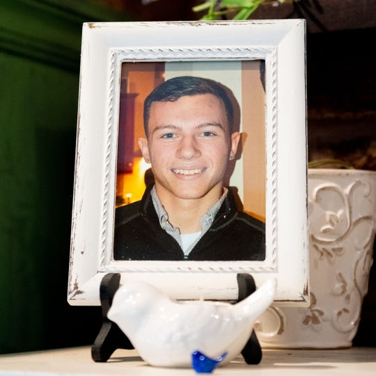 Joseph Dolan died of a drug overdose. He was the second Dolan child to die. His parents keep a framed picture of him on the mantel of their fireplace, July 2, 2019.