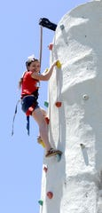 Emily Dominick, 11, of Fernley, tops out the climbing wall.