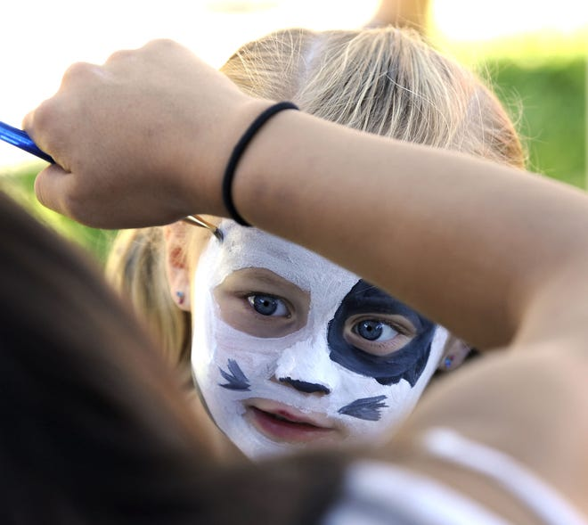 Paige Feole, 3, of Yerington, has her face painted to look like a puppy.