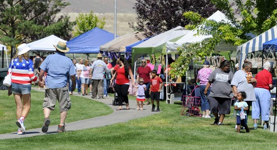 Vendor booths line Mountain View Park on July 4.