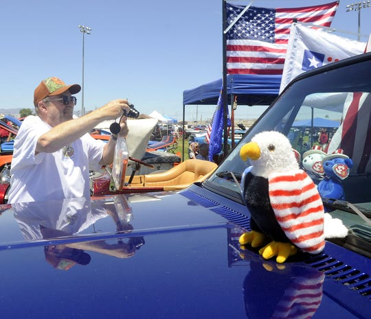 Wynn Allred of Winnemucca takes a photo at the show n' shine.