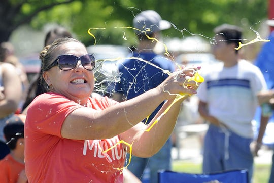 Sarah Thomas of Yerington gets doused in yolk after catching a raw egg at the wrong angle.
