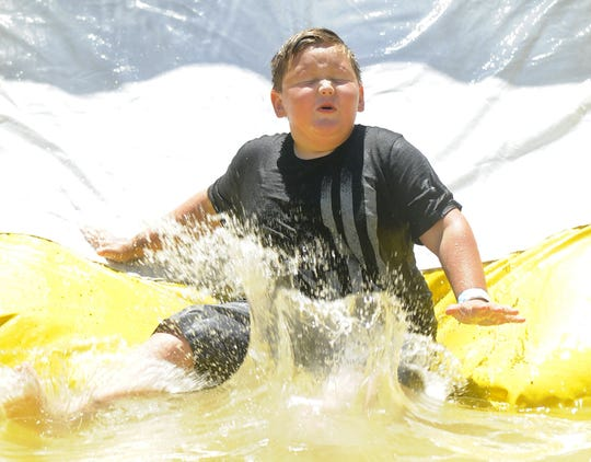 Isaac Cervantes, 7, of Fernley, splashes down on a waterslide.