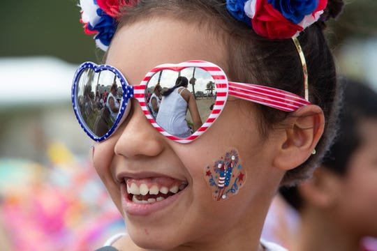 Alexandra Martinez 11-years-old smiles at the Big Bang Family Fun and Music Zone during the 4th of July celebration at Water's Edge Park on July 4, 2019.