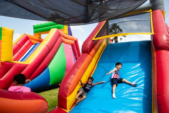 Kids play at the Big Bang Family Fun and Music Zone during the 4th of July celebration at Water's Edge Park on July 4, 2019.