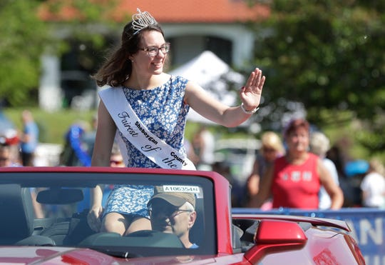 Fairest of the Sheboygan County Fair Sarah Deheck waves during the Sheboygan July Fourth parade in Sheboygan.