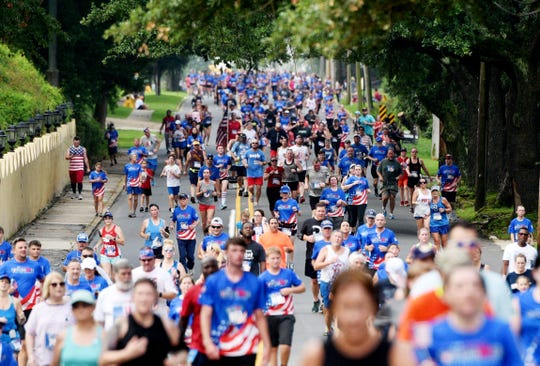 The 35th Sportspectrum Firecracker 5k Race for Research Run Thursday, July 4, 2019, in the South Highland neighborhood.