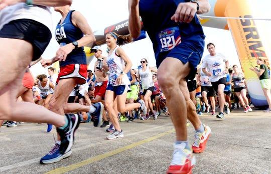 The 35th Sportspectrum Firecracker 5k Race for Research Run Thursday, July 4, 2019, in the South Highland neighborhood.