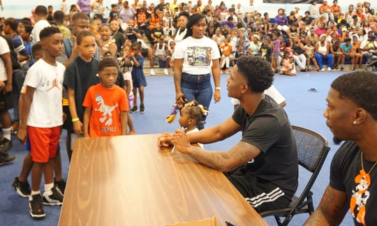 """""""Lee Lee"""" Williams (far right) and """"Greedy"""" Williams wait to greet hundreds of children Wednesday."""