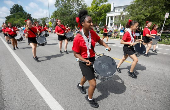 The Central High School Kiltie Drum & Bugle Corps performs at the Fourth of July parade in Midtown on Thursday.