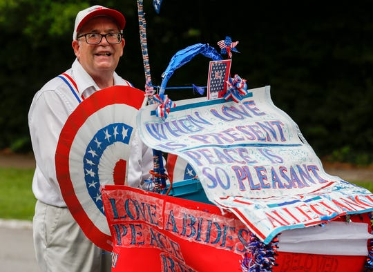 Danny Lee Henderson marches in Springfield's Old Fashioned 4th of July Parade on Thursday.