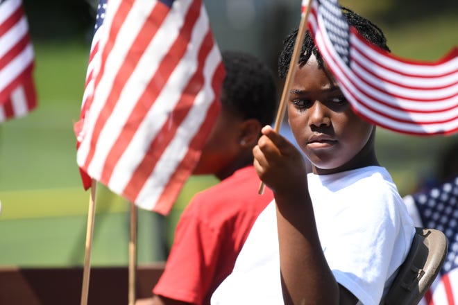 Flags wave during the Happy Birthday America July 4th Parade in Gypsy Hill Park, Staunton, Va., July 4, 2019.