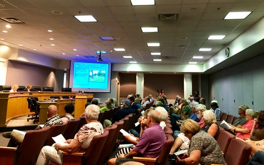 People listen to the Augusta County Board of Zoning Appeals discuss an appeal concerning Flow Beverages on Wednesday at the Augusta County Government Center.