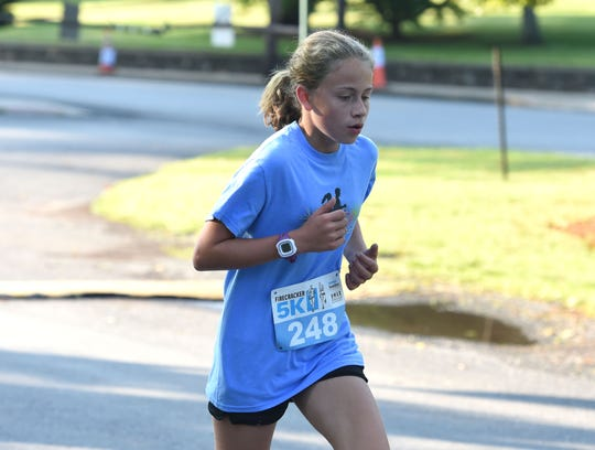 Quinn Franklin, 13, ran The News Leader Firecracker 5K Thursday morning with her parents and younger sister.